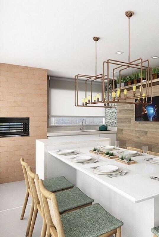 Lustre moderno para área gourmet decorada com revestimento tijolinho Foto Pinterest