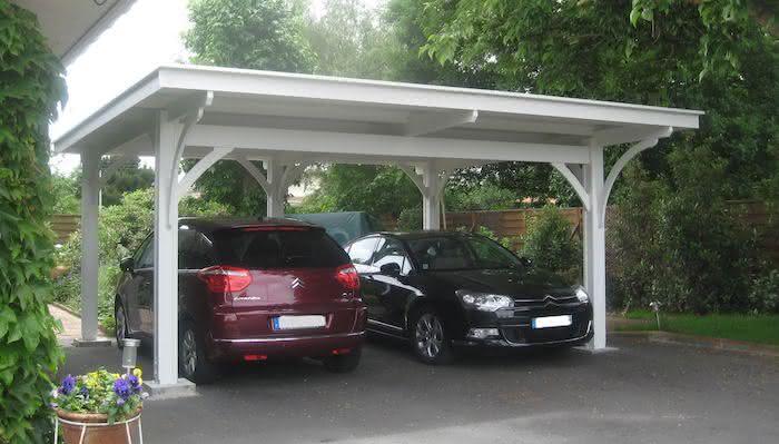 Modelos de garagem com pergolado para dois carros estacionados