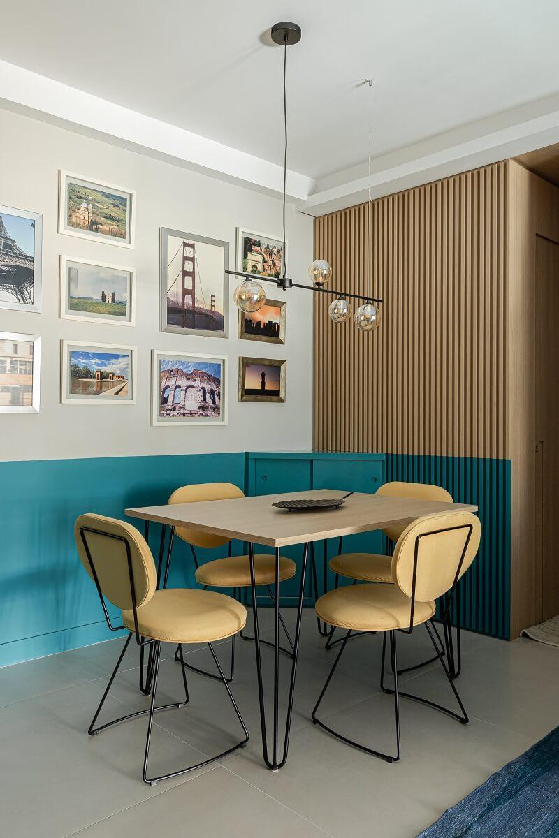 O tamanho da mesa de jantar e das cadeiras respeita o altura da pintura azul na parede. Foto: Gisele Rampazzo