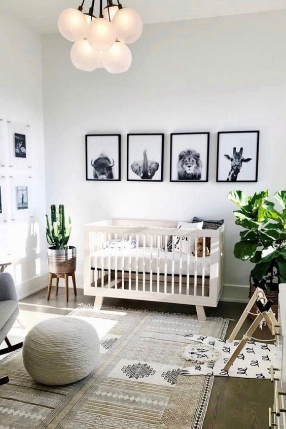 Quarto de bebe moderno com quadros de animais