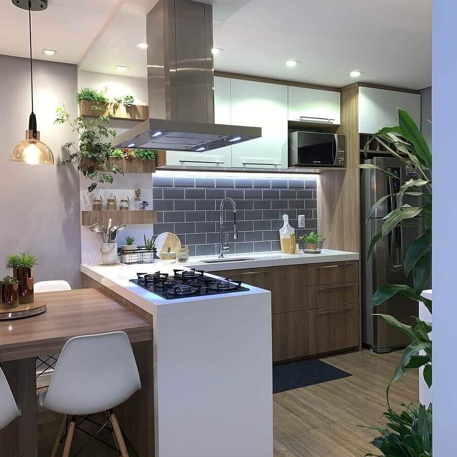 Bancada com cooktop e mesa integrada para decoração de sala e cozinha americana Foto Casa da Montanha 04