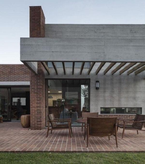 Casa moderna com pergolado de concreto. Fonte: Arkpad