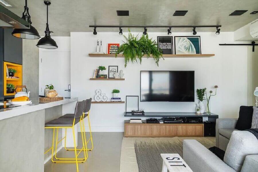 Cimento queimado para decoração de sala e cozinha americana Foto SP Estúdio Arquitetura