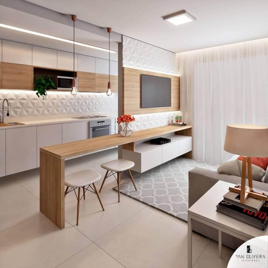 Cores claras para decoração de sala e cozinha americana pequena com revestimento 3D Foto Yan Oliveira