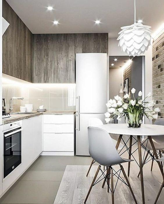 Cozinha pequena com mesa eiffel e lustre branco