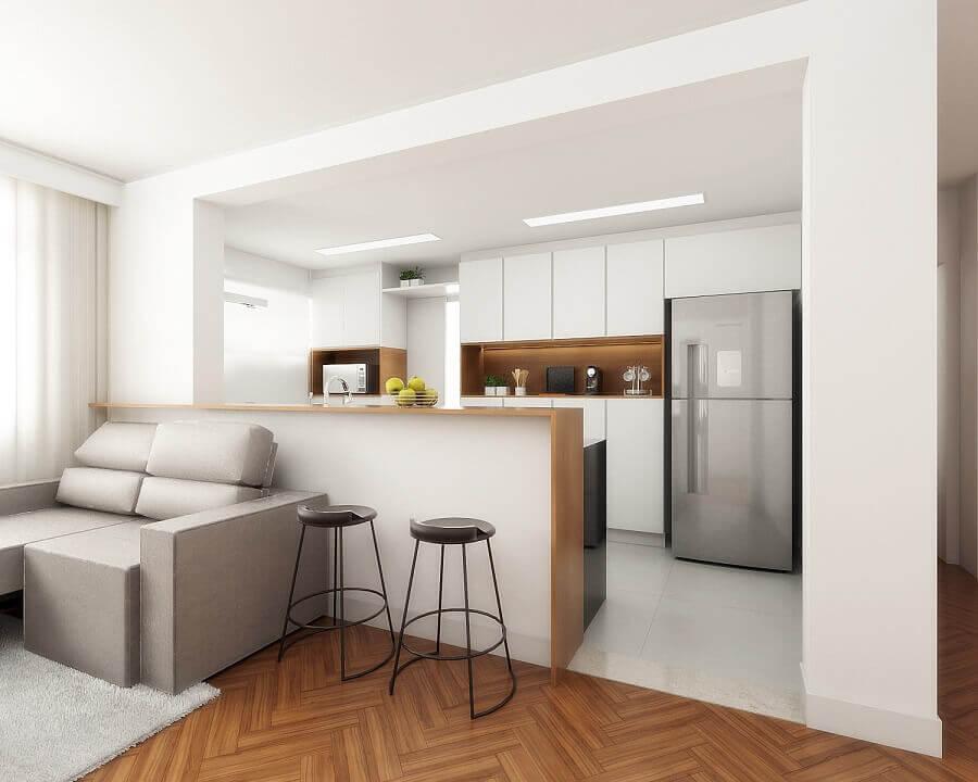 Decoração clean com armários planejados para sala e cozinha americana pequena Foto Spaze Arquitetura e Interiores