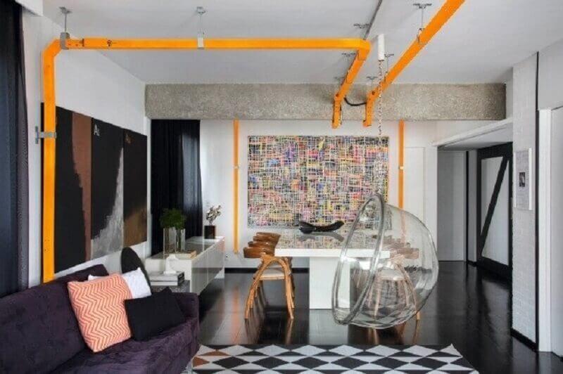 Decoração estilo industrial para sala de estar e jantar integrada com balanço suspenso Foto Round Square