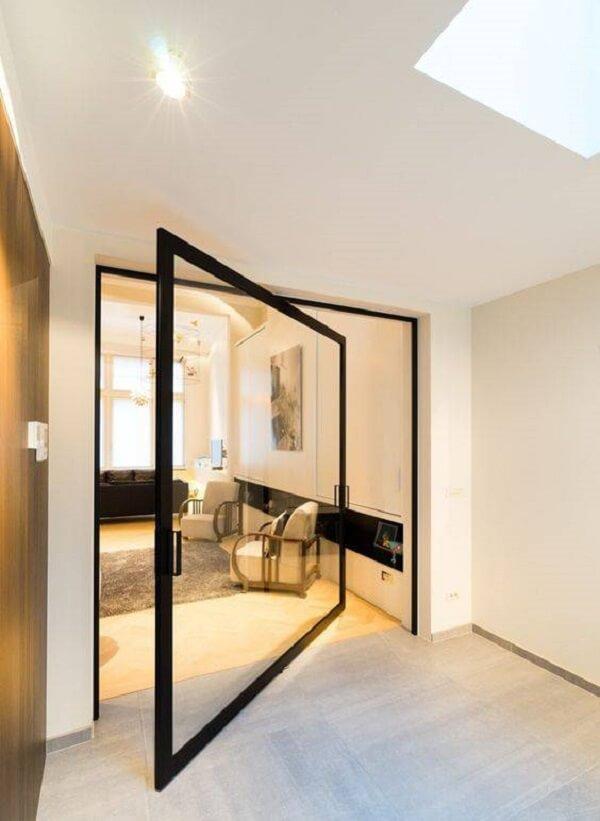 Modelo de porta de vidro para sala com design pivotante. Fonte: Archello