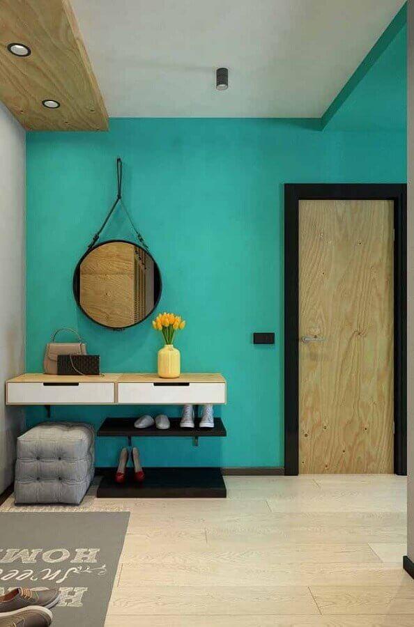 Parede cor ciano para hall decorado com aparador suspenso Foto Decor Fácil