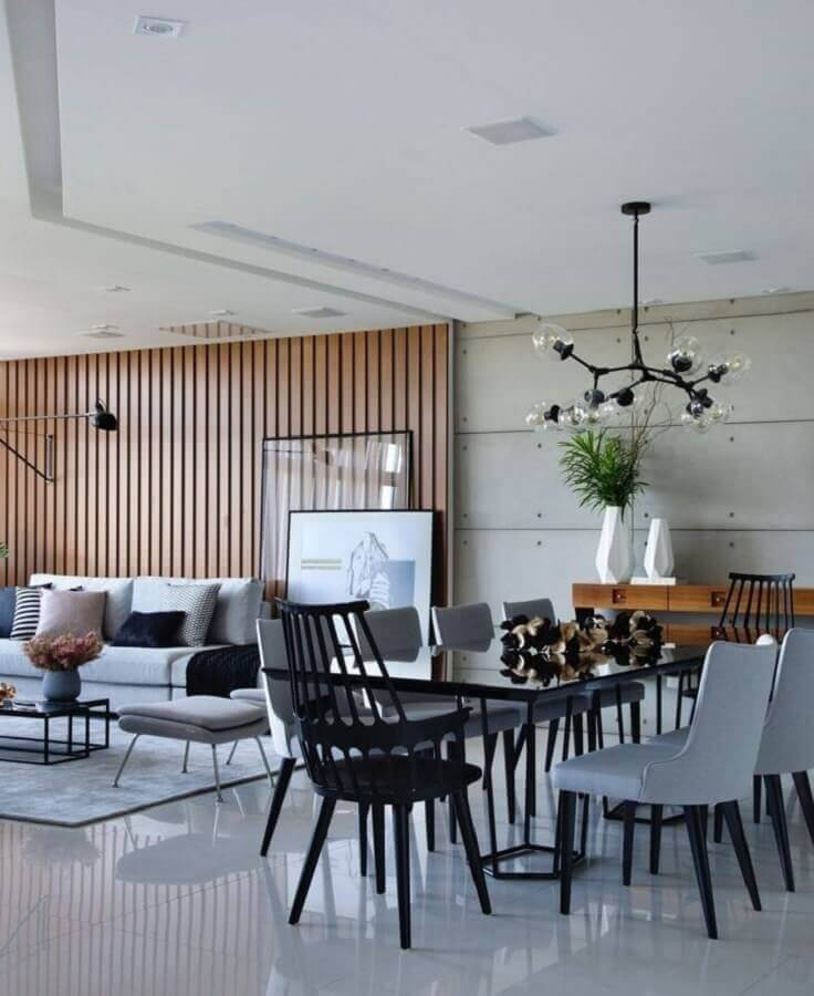 Parede de madeira para decoração de sala de estar e jantar integradas modernas Foto Futurist Architecture