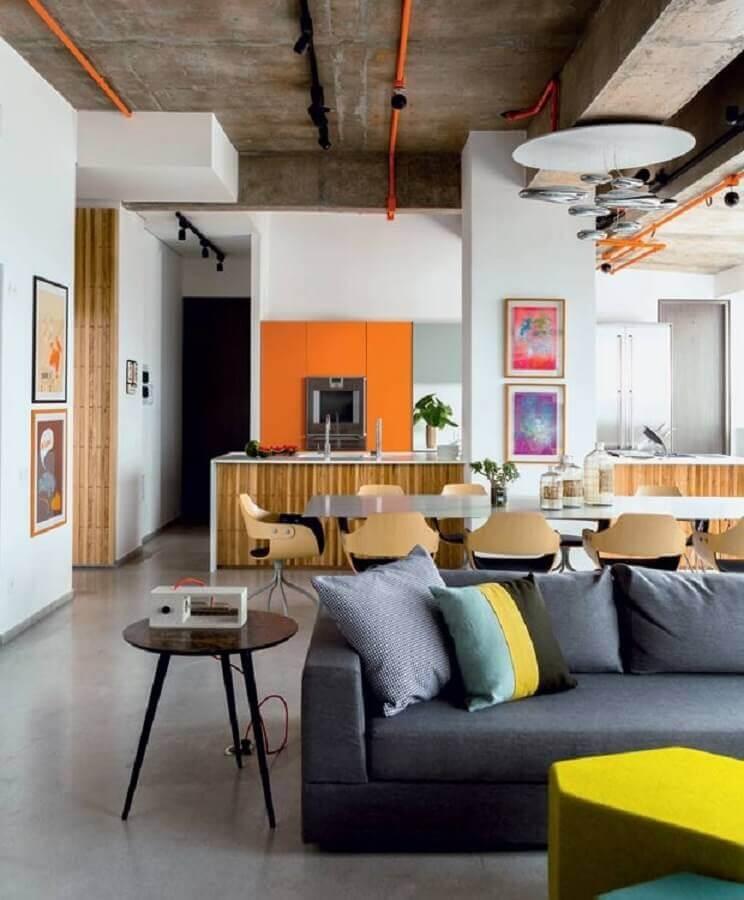 Sala de estar e jantar integrada decoradas com estilo industrial Foto Estúdio Cada Um