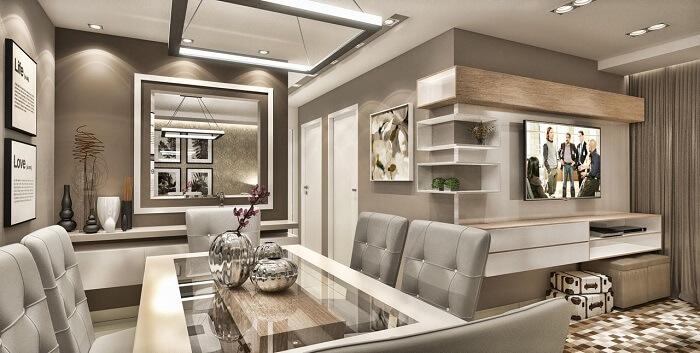 Sala de jantar de apartamento de luxo com mesa de vidro. Fonte: Caroline Yasmin Goncalves