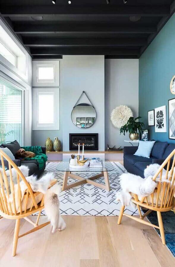 tons de cinza para decoração com espelho redondo na sala com lareira Foto Home Fashion Trend