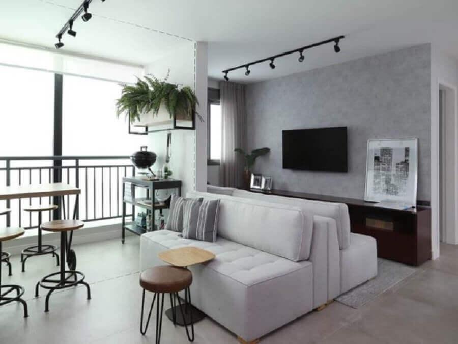 Vasos com plantas para decoração de sala com varanda integrada Foto Mandril Arquitetura