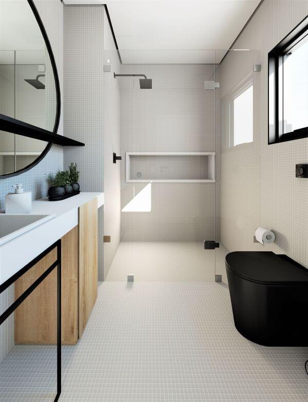 Banheiro cinza com nicho de porcelanato branco em destaque
