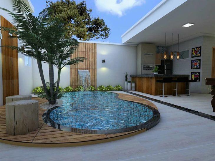 Quintal com piscina e churrasqueira moderna